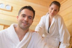 Happy couple enjoying sauna together at spa. Happy couple enjoying the sauna together at the spa Stock Photo
