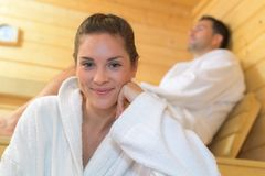 Happy couple enjoying sauna together at spa. Happy couple enjoying the sauna together at the spa Royalty Free Stock Images