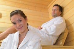 Happy couple enjoying sauna together at spa. Happy couple enjoying the sauna together at the spa Royalty Free Stock Photography