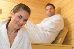 Happy couple enjoying sauna together at spa. Happy couple enjoying the sauna together at the spa Royalty Free Stock Image