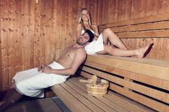 Happy couple enjoying the sauna together at the spa.  Stock Photo