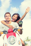 Happy Couple Enjoying Scooter Ride Against Sky Stock Photography