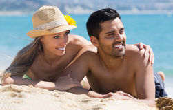 Happy couple enjoying on sea shore Royalty Free Stock Photography