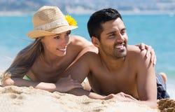 Happy couple enjoying on sea shore Royalty Free Stock Photography