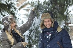Happy couple enjoying snowfall Royalty Free Stock Images
