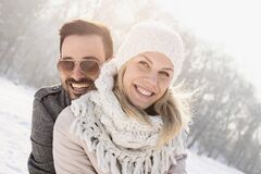 Free Happy Couple Enjoying The Beautiful Snow Captured On A Cold And Snowy Day Stock Photo - 194062500
