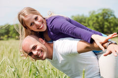 Happy couple enjoying with their arms outstretched Stock Photo