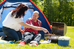 Happy couple enjoying their bbq Royalty Free Stock Photography