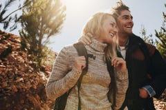 Couple enjoying on their hiking trip. Happy couple enjoying on their hiking trip. Caucasian couple having fun on summer vacation stock photos