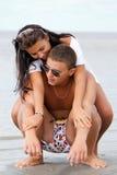 Happy couple enjoying vacations Stock Images
