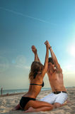 Happy couple enjoying vacations on the beach Royalty Free Stock Images