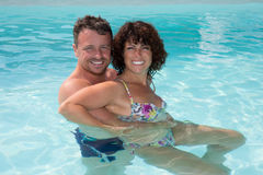 Happy couple enjoying vacations in the water at summer Stock Photos