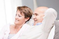 Happy couple enjoying watching television Stock Image