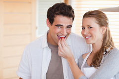 Happy couple enjoys cooking together Royalty Free Stock Photos