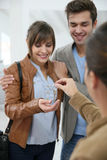 Happy couple entering in brand new home Stock Photos