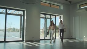 Happy couple entering modern home. Cheerful couple buy mortgage home. Wife and husband buy new house. Family estate dream. Man and woman looking house stock video footage