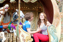 Happy couple in an equipage of vintage Parisian merry-go-r. Happy young couple in an equipage of vintage Parisian merry-go-round stock photos