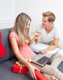 Happy couple exchanging gifts Royalty Free Stock Photography