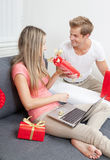 Happy couple exchanging gifts Royalty Free Stock Photo