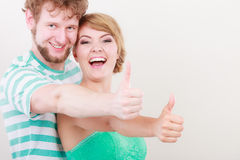 Happy couple excited smiling holding thumb up gesture, Stock Image