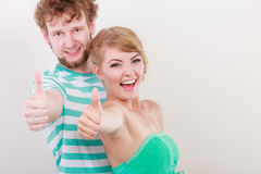 Happy couple excited smiling holding thumb up gesture, Royalty Free Stock Photo