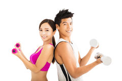 Happy couple exercising with dumbbell Royalty Free Stock Image
