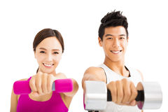 Happy couple exercising with dumbbell Royalty Free Stock Images