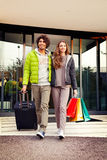 Happy couple exit the airport Royalty Free Stock Photography