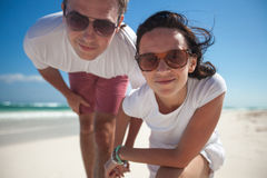 Happy couple on exotic beach looking at camera Stock Image