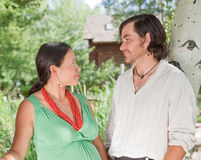 Happy couple expecting a baby. Happy young couple expecting a baby - looking at each other Royalty Free Stock Images