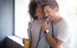 Happy couple expressing their love through tenderness. How happiness looks. Delighted young sweet couple expressing their love through tenderness while embracing Royalty Free Stock Photos