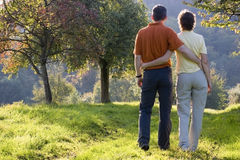 Happy couple in fall. Couple hiking at sunset in fall Stock Photo