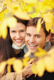 Happy couple in fall forest Royalty Free Stock Image