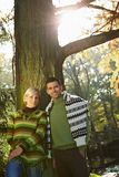 Happy couple in fall forest outdoor low angle Royalty Free Stock Photography