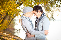 Happy couple in fall under leaves Stock Image