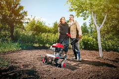 Happy couple of a family of farmers on their garden rejoice on a Stock Images