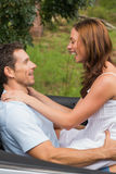 Happy couple feeling romantic in back seat and laughing Royalty Free Stock Photography