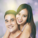 Happy couple with festive light background Royalty Free Stock Photography