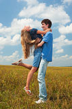 Happy couple on field Royalty Free Stock Image