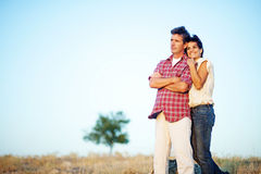Happy couple in a field Stock Photography