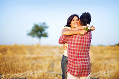 Happy couple in a field Royalty Free Stock Photography