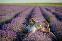 Happy couple in a field of lavender stock photos