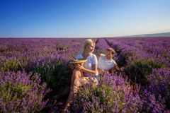 Happy couple in a field of lavender. A loving couple walks in the field of lavender, dreams and smiles. They are happy together and love each other stock photos