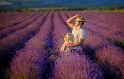 Happy couple in a field of lavender royalty free stock images