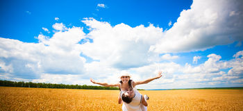 Happy couple in the field of wheat with blue sky Stock Photo