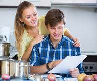 Happy couple filling forms for joint banking Royalty Free Stock Images
