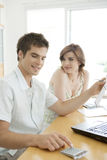Happy Couple Finances on Desk royalty free stock photos
