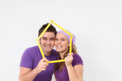 Happy couple first house loan or mortgage. Happy couple planing first new home mortgage or house insurance concept royalty free stock photography