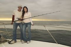 Happy Couple Fishing On Yacht Royalty Free Stock Images