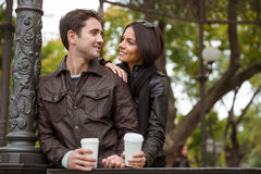 Happy couple flirting outdoors Stock Images